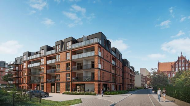 Młyny Gdańskie. Widok planowanego osiedla od strony ulicy Malczewskiego. Budynek szkoły po drugiej stronie ulicy był inspiracją dla architektów do wykończenia budynków cegłą.