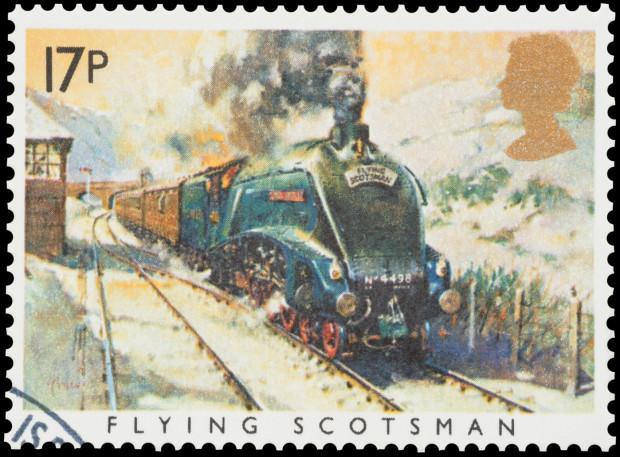 """Brytyjski znaczek pocztowy z """"Latającym Szkotem""""."""