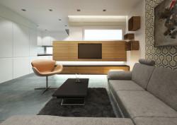 Zaokrąglone rogi w szafce pod telewizorem i półkach wiszących na ścianie to detale, które uspójniają wnętrze.