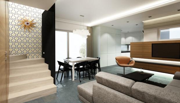 W pomieszczeniu, które łączy funkcję korytarza, salonu i jadalni zastosowano jeden rodzaj podłogi, aby uniknąć wrażenia wizualnego podziału przestrzeni.