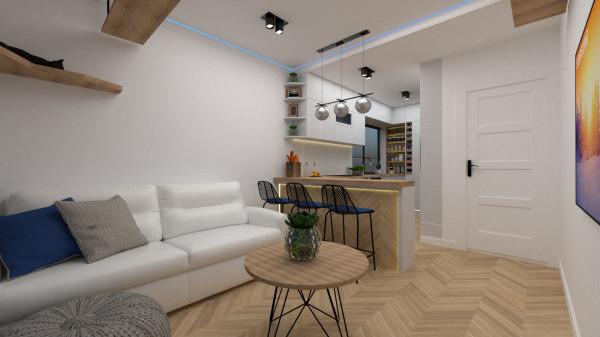 Pierwsza koncepcja została zachowana w jasnej kolorystyce. Biel optycznie powiększa niewielkie wnętrze, a drewno ociepla aranżację.