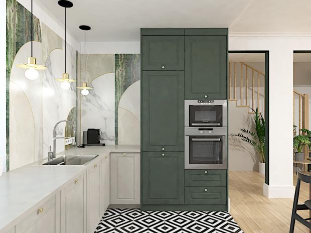 Fronty kuchenne w drugiej koncepcji zostały zachowane w szarości i butelkowej zieleni.
