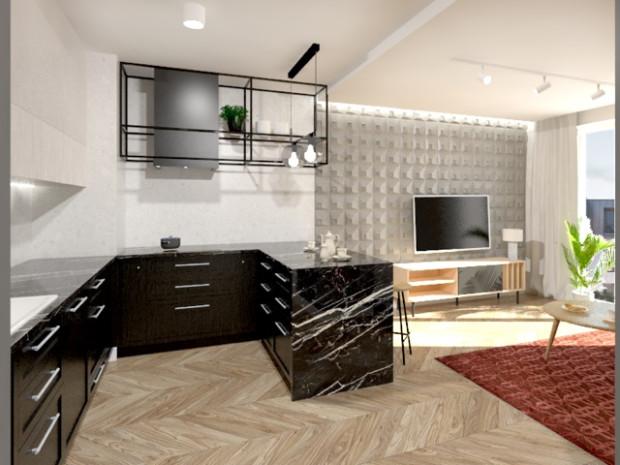 Ciemne fronty szafek kuchennych i kamienny blat dodają wnętrzu elegancji i wyrazistego charakteru.