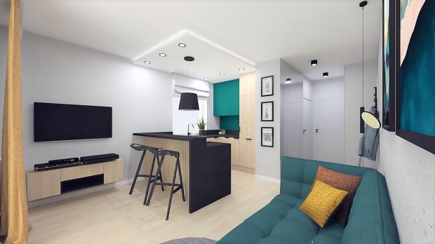 Druga koncepcja zakłada styl loftowy w lekkim wydaniu z rozbudowaną zabudową kuchenną.