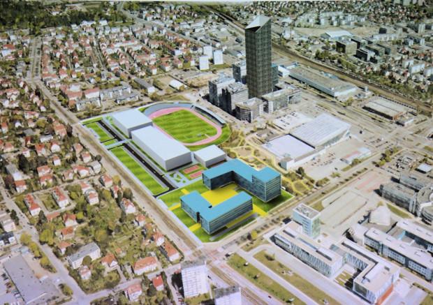 Potencjalna forma zabudowy mieszkaniowej na terenie UG. Dalej widać bryłę budynków centrum sportowego.