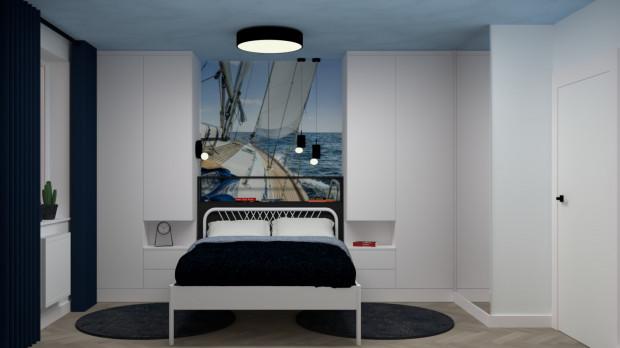 W pierwszej koncepcji łóżko znajduje się po środku jednej ze ścian.