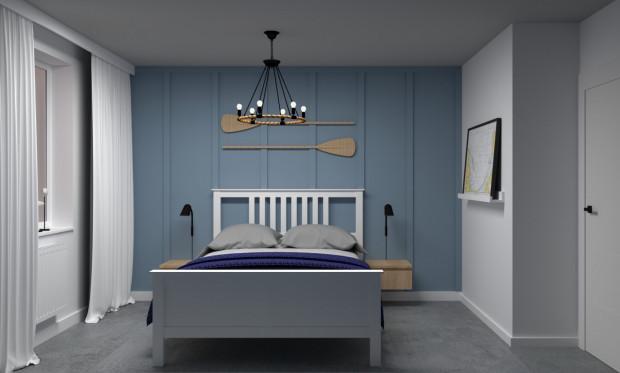 Ściana za łóżkiem została pomalowana na błękitny kolor. Nad łóżkiem znalazły się dekoracyjne wiosła.