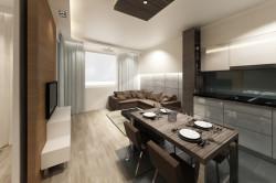 Surowa, betonowa ściana za kanapą tworzy kontrast z kanapą w ciepłym, czekoladowym kolorze.