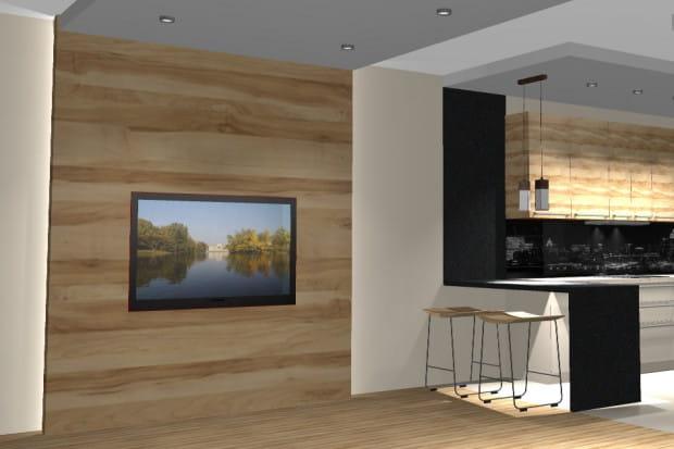 Koncepcja druga. Jasne drewno bądź okładziny drewnopodobne zastosowane za telewizorem i na frontach kuchennych szafek sprawią, że wnętrze będzie nie tylko przytulne ale też - optycznie - nieco większe.