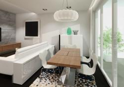 Za kanapą znajduje się dodatkowy kredens, który stanowi dodatkową przestrzeń przechowalniczną oraz umowną granicę między jadalnią a salonem.