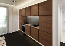 Drewniane fronty kuchennej zabudowy mają taką samą okleinę jak meble pod sprzęt rtv.