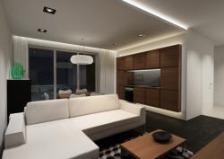 """Do oświetlenia pomieszczenia zastosowano paski ledowe, oczka w suficie, oświetlenie punktowe nad stołem i oświetlenie blatu roboczego w """"kuchni""""."""