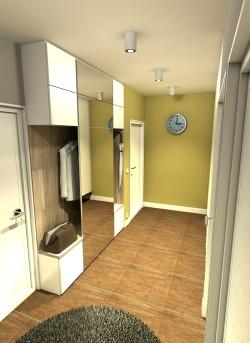 Wariant kolorystyczny łagodny. Widok od strony łazienki na zabudowę meblową z szafkami oraz szufladami, a także drążkami na zawieszenie odzieży wierzchniej.