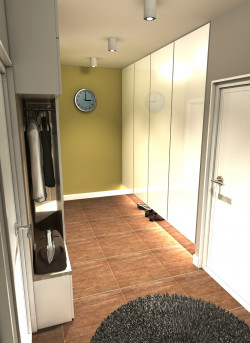 Wariant kolorystyczny łagodny. Widok od strony sypialni na obie szafy w zabudowie usytuowane w przedpokoju.